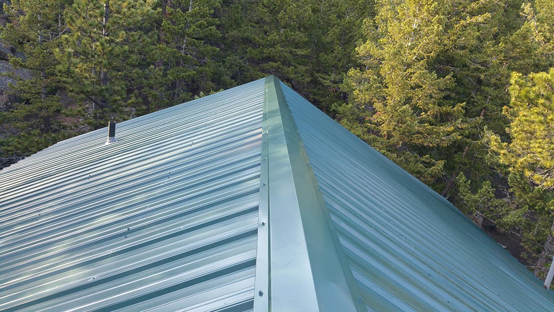 New Metal Residential Roof Replaces Worn Out Shake Red