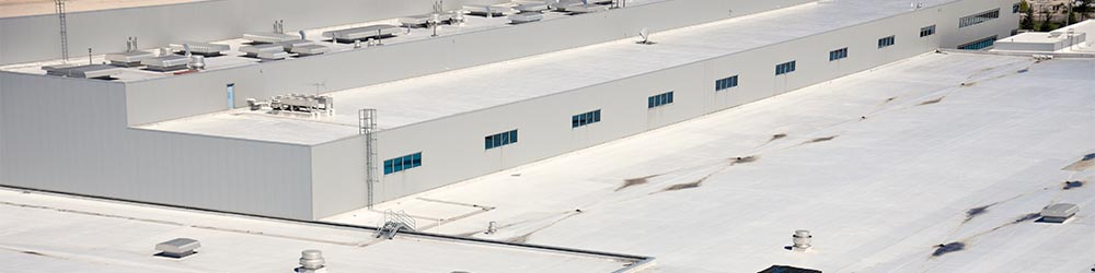 a flat roof on a commercial building