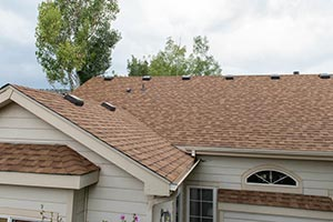 house with an asphalt shingle roof
